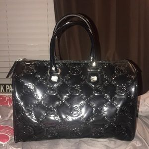 76ccc1ed245c Women s Hello Kitty Embossed Bag on Poshmark